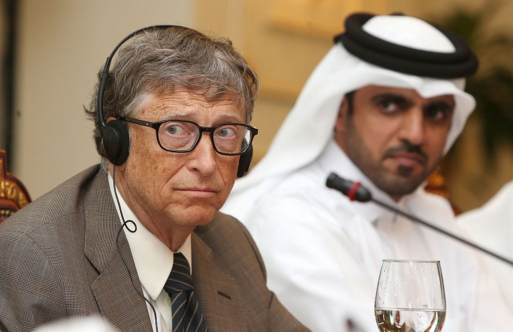 Bill Gates (L), Microsoft founder and co-chairman of the Bill and Melinda Gates Foundation (R) and Khalifa bin Jassim al-Kuwari, the Director General of the Qatar Development Fund, give a press conference after a signing ceremony on April 13, 2016 in Doha.(Photo by KARIM JAAFAR/AFP/Getty Images)