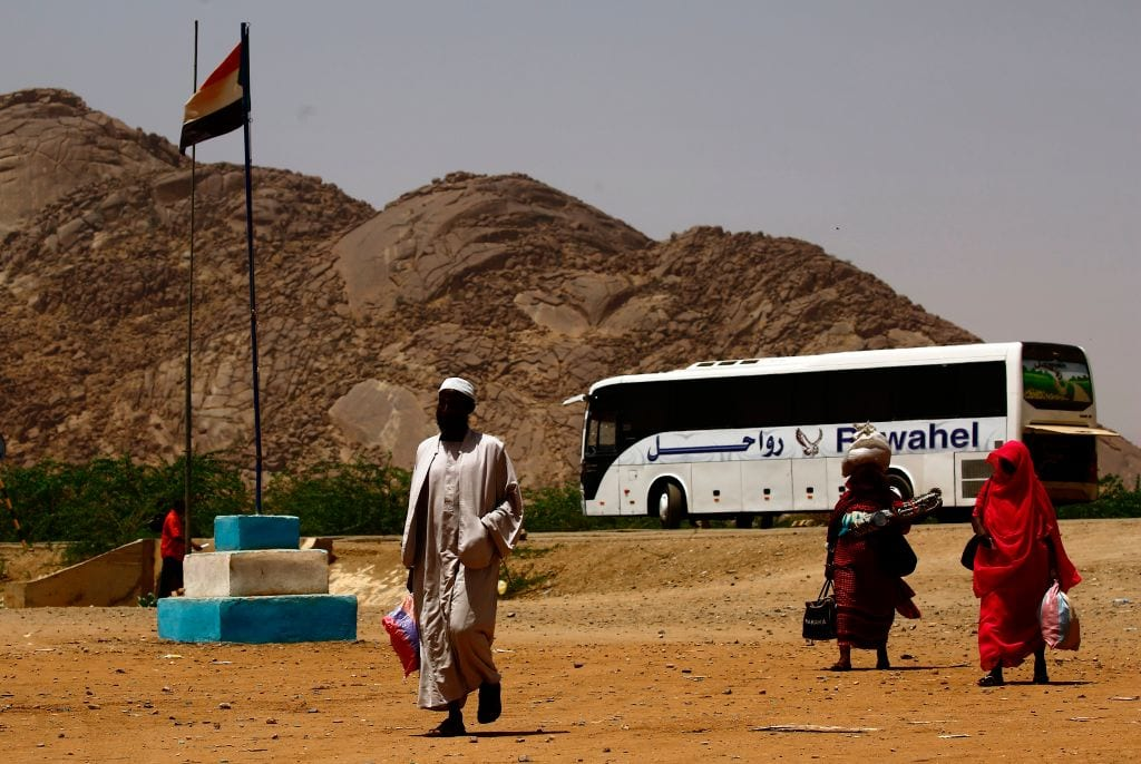 Illegal migrants from Eritrea arrive at the al-Laffa border crossing in Sudan's eastern Kassala state on the Eritrea-Sudan border prior to being deported from Sudan back to their homeland on 2 May 2017. [ASHRAF SHAZLY/AFP/Getty Images]