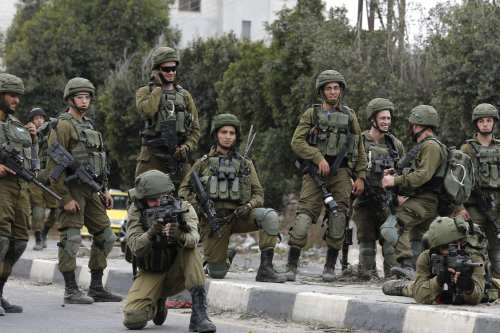 Israeli security forces are seen near the Huwara checkpoint south of Nablus in the Israeli-occupied West Bank on 22 December 2017 [JAAFAR ASHTIYEH/AFP/Getty Images]