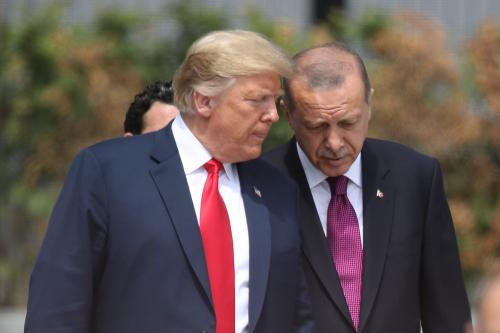 US President Donald Trump (L) and Turkish President Recep Tayyip Erdogan attend the opening ceremony at the 2018 NATO Summit at NATO headquarters on July 11, 2018 in Brussels, Belgium. Leaders from NATO member and partner states are meeting for a two-day summit, which is being overshadowed by strong demands by U.S. President Trump for most NATO member countries to spend more on defense. (Photo by Sean Gallup/Getty Images)