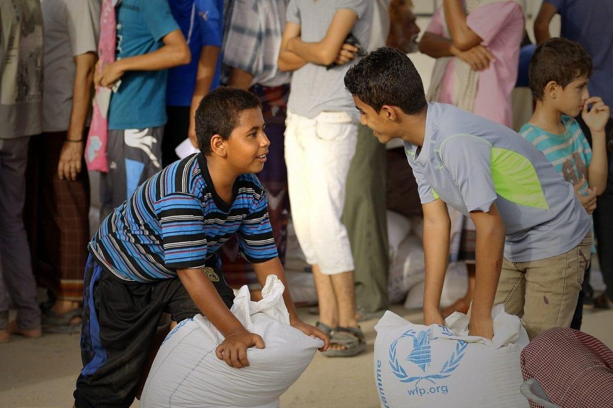 Yemenis receive food aid from the UN's World Food Programme (WFP), in the al-Mansorah district of Aden, Yemen in 2016 [Ammar Bamatraf / WFP]