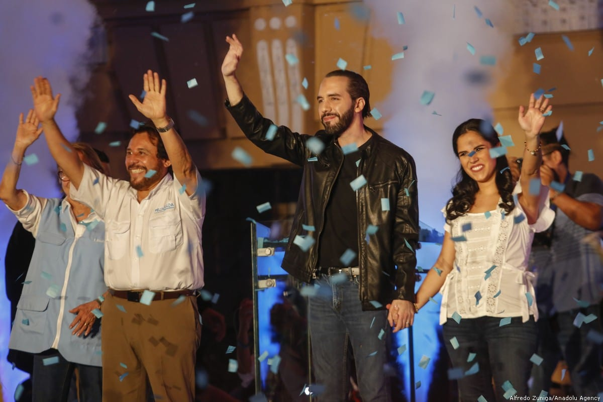 El Salvador presidential candidate Nayib Bukele (2-R) of the Great National Alliance (GANA), his wife Gabriela Rodriguez (R) and Vice President Felix Ulloa (2-L) celebrate after winning the presidential elections in Plaza Morazan, San Salvador on 3 February 2019