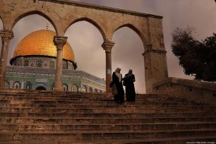 Women walk by the Dome of the Rock at the Al-Aqsa mosque compound in the Old City on 1 December 2014 in Jerusalem, [Spencer Platt/Getty Images]