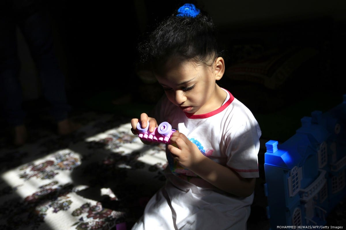 A Yemeni girl plays with toys in Sanaa, Yemen [MOHAMMED HUWAIS/AFP/Getty Images]