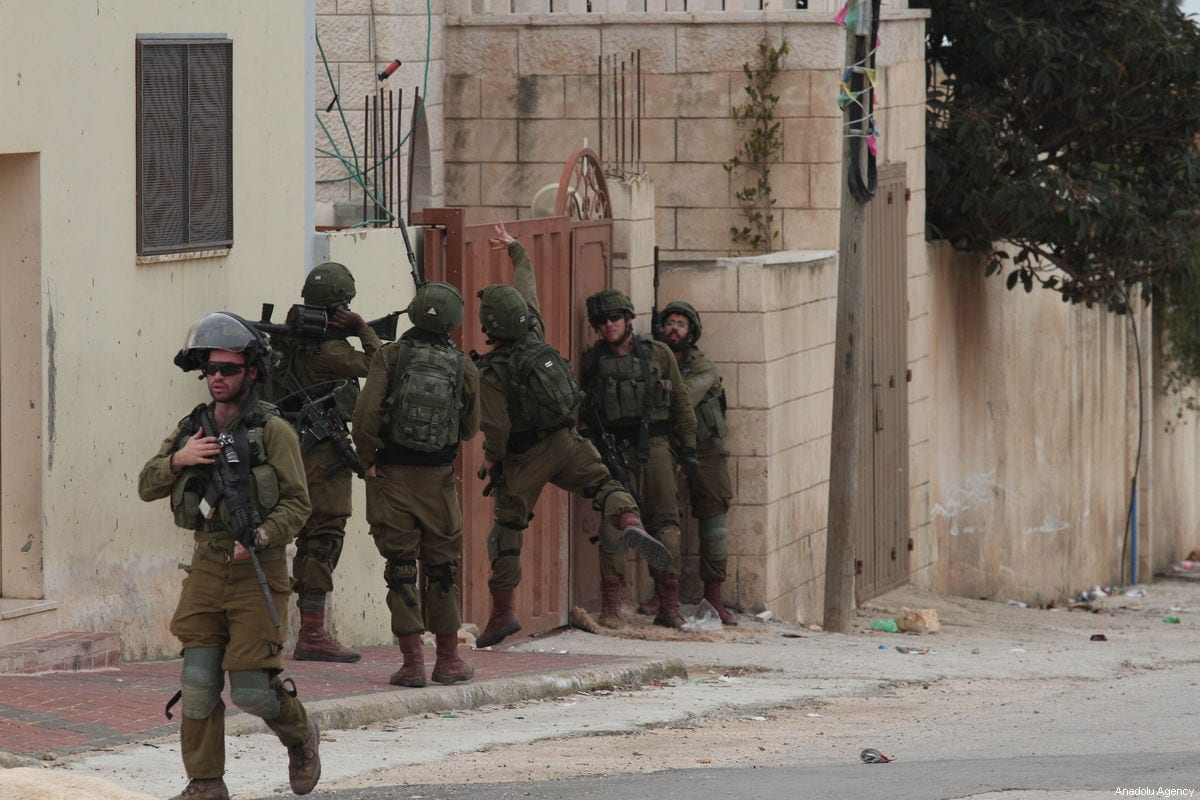 Israeli forces' throw a grenade into a property, while chasing Palestinian protestors during a protest against building of illegal settlements at the Kafr Qaddum village of Nablus, West Bank on February 01, 2019 [Nedal Eshtayah / Anadolu Agency]