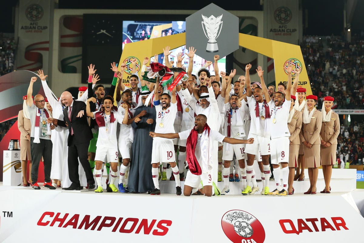 Qatar's players celebrate with the trophy after winning the 2019 AFC Asian Cup final match between Japan and Qatar in Abu Dhabi, United Arab Emirates, on 01 February 2019. [STRINGER - Anadolu Agency]