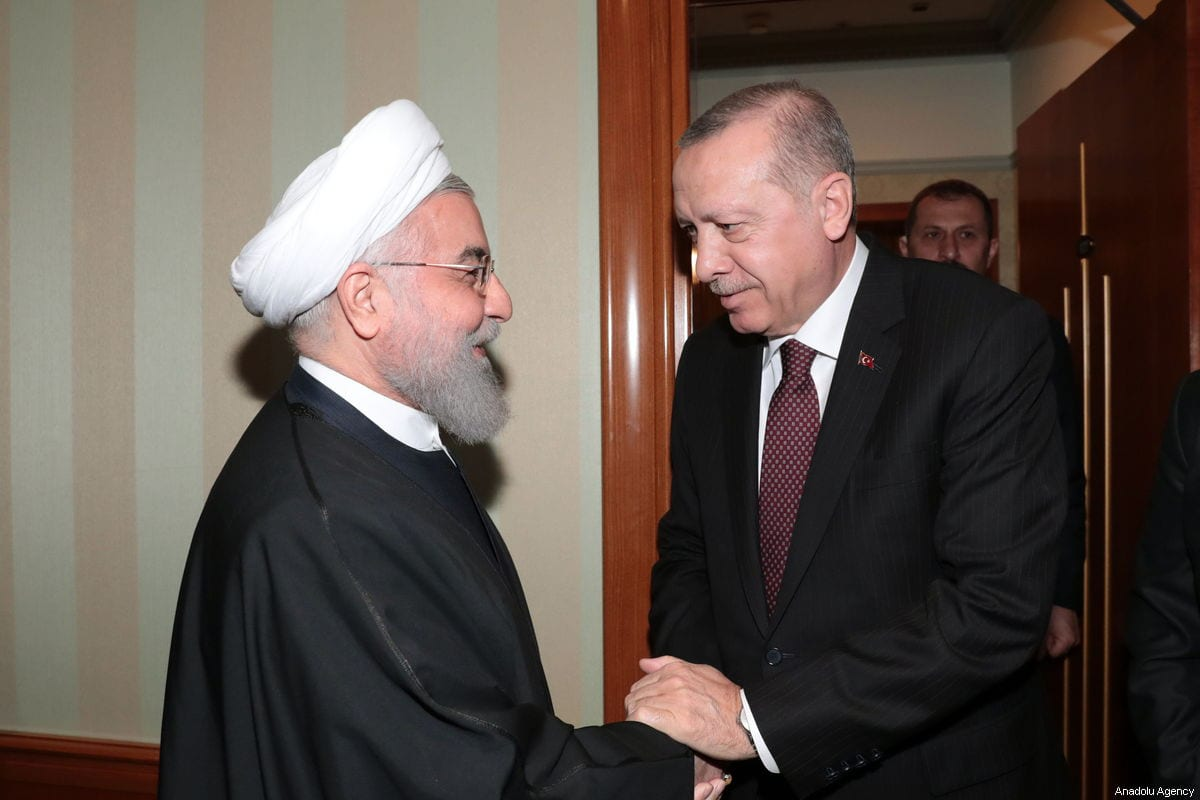 """SOCHI, RUSSIA - FEBRUARY 14 : (----EDITORIAL USE ONLY – MANDATORY CREDIT - """"TURKISH PRESIDENCY / MURAT CETINMUHURDAR / HANDOUT"""" - NO MARKETING NO ADVERTISING CAMPAIGNS - DISTRIBUTED AS A SERVICE TO CLIENTS----) President of Turkey, Recep Tayyip Erdogan (R) shakes hands with President of Iran, Hassan Rouhani (L) in Russia's coastal city of Sochi ahead of the trilateral summit on Syria on February 14, 2019. ( TURKISH PRESIDENCY / MURAT CETINMUHURDAR / HANDOUT - Anadolu Agency )"""