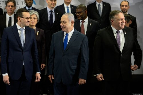 """(L-R) Polish Prime Minister, Mateusz Morawiecki, Israeli Prime Minister, Benjamin Netanyahu and US Secretary of State Mike Pompeo are seen during the family photo at the"""" Ministerial to Promote a Future of Peace and Security in the Middle East"""" co hosted by US and Poland in the National Stadium in Warsaw, Poland on February 14, 2019 [Omar Marques / Anadolu Agency]"""