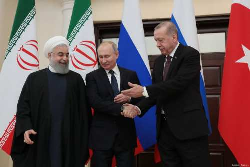 Turkish President Recep Tayyip Erdogan (R), Iranian President Hassan Rouhani (L) and Russian President Vladimir Putin (C) arrive to attend the 4th trilateral summit on Syria on 14 February 2019 in Sochi, Russia. [Turkish Presidency/Murat Cetinmuhurdar/Handout/Anadolu Agency]