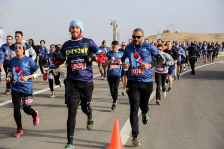 People gather to run for a public run with the attendance of four thousands people from different countries, around the Great Pyramid of Giza, which is located in the western part of capital city Cairo, in Egypt on 15 February 2019. [Ahmed Al Sayed - Anadolu Agency]