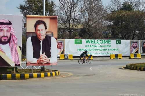Billboards showing portraits of Saudi Arabia's Crown Prince Mohammed Bin Salman (L) and Pakistan's Prime Minister Imran Khan (R) in Islamabad on 15 February 2019 [AAMIR QURESHI/AFP/Getty Images]