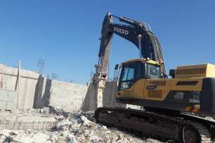 In order to avoid a heavy fine, a Palestinian man was forced to demolish his own home