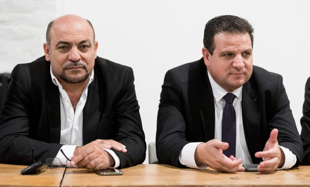 Member of the Knesset for the United Arab List Masud Ghnaim (L) and Ayman Odeh (R) member of the Knesset and head of the Joint List, a political alliance of four Arab-dominated parties Hadash, Balad, the United Arab List, and Ta'al during a conference organised by Abp Asbl (Association belgo palestinienne) on September 3, 2018 in Brussels, Belgium. [Thierry Monasse/Getty Images]