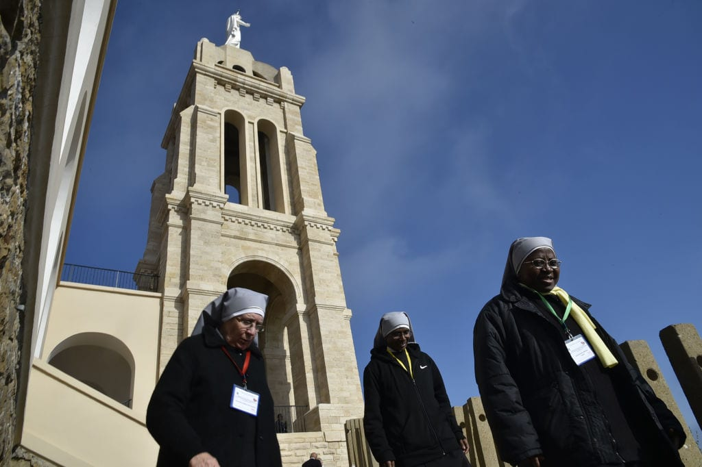 Nuns attend a ceremony at the Chapel of our Lady of Santa Cruz in Algeria's northern city of Oran, during which seven French monks and 12 other clergy killed during the country's civil war were beatified, on December 8, 2018. [RYAD KRAMDI/AFP/Getty Images]