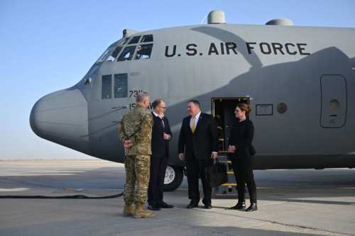 US Secretary of State Mike Pompeo (C) and his wife Susan (R) are welcomed by US ambassador to Iraq Douglas Silliman (2nd-L) as they arrive in Baghdad, during a Middle East tour, on 9 January 2019. [ANDREW CABALLERO-REYNOLDS/AFP/Getty Images]
