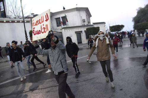 Algerian protesters are pictured during clashes with the police during a demonstration against Algeria's president's candidacy for a fifth term, on February 22, 2019 in the capital Algiers. [RYAD KRAMDI/AFP/Getty Images]