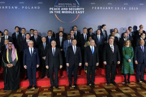 Participants, including U.S. Vice President Mike Pence, US Secretary of State Mike Pompeo, Polish President Andrzej Duda and Israeli Prime Minister Benjamin Netanyahu, attend a group photo prior to the dinner on the opening evening of the Ministerial to Promote Peace and Security in the Middle East on February 13, 2019 in Warsaw, Poland. [Sean Gallup/Getty Images]
