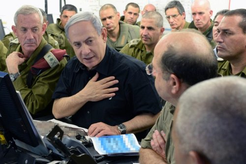 Israeli Prime Minister Benjamin Netanyahu (C), and IDF Chief of Staff Benny Gantz (L) visit a tactical headquarters of the IDF in southern Israel near the border with Gaza on July 21, 2014 in near Beersheba, Israel. [Kobi Gideon/GPO via Getty Images]