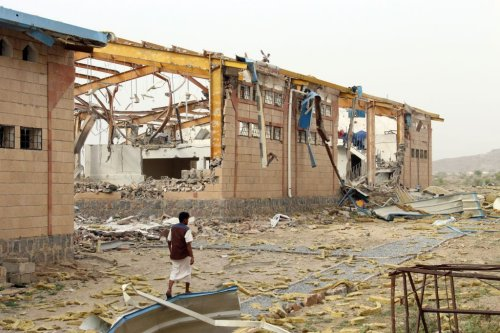 A Yemeni man inspects the damage caused by a Saudi-led air strike on a cholera treatment centrer supported by Doctors Without Borders (MSF) in the Abs region of Yemen on 11 June 2018. [ESSA AHMED/AFP/Getty Images]