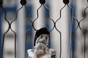 A marionette puppet, made by Palestinian artist Mahdi Karera, is seen at his house [AFP]