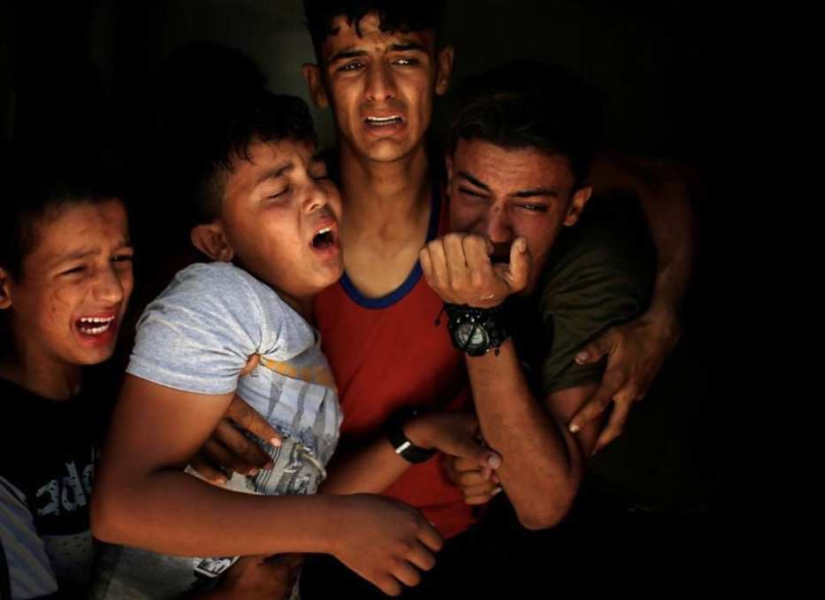 The winning photograph of Palestinian photographer Mohammed Salem shows four Palestinian children crying while they were bidding farewell to their brother, who was killed on 15 May during the Gaza protests.