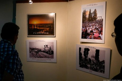 Visitors view the photo exhibition about history of Palestine during the 54th Anniversary of the Palestinian Revolution in Jakarta, Indonesia on 27 February 2019 [Anton Raharjo/Anadolu Agency]