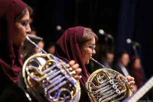 Members of Tehran Symphony Orchestra perform a concert at Vahdat Hall in memory of the 250th anniversary of German composer Ludwig van Beethoven's birth, on 8 March 2019 in Tehran, Iran. [Fatemah Bahrami/Anadolu Agency]