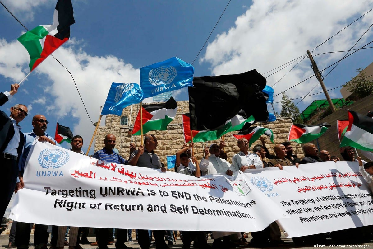 Palestinians protest against US President Trump's decision to stop funding UNRWA on 8 September 2018 [Wisam Hashlamoun