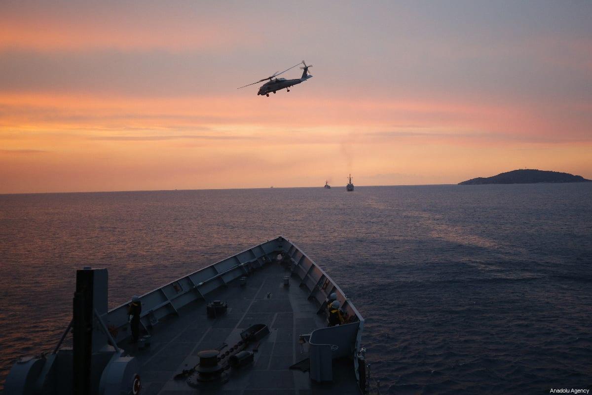 Sikorsky SH-60 Seahawk accompanies frigates deployed at Aegean Sea within 'Blue Homeland 2019' military exercise offshore Mugla, Turkey on February 27, 2019. [Mustafa Çiftçi - Anadolu Agency]