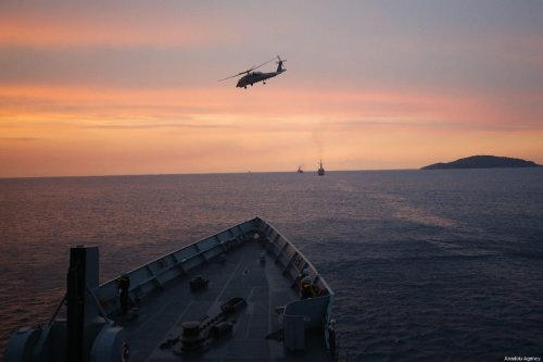 Sikorsky SH-60 Seahawk accompanies frigates deployed at Aegean Sea within 'Blue Homeland 2019' military exercise offshore Mugla, Turkey on February 27, 2019. [Mustafa Çiftçi - Anadolu Agency]
