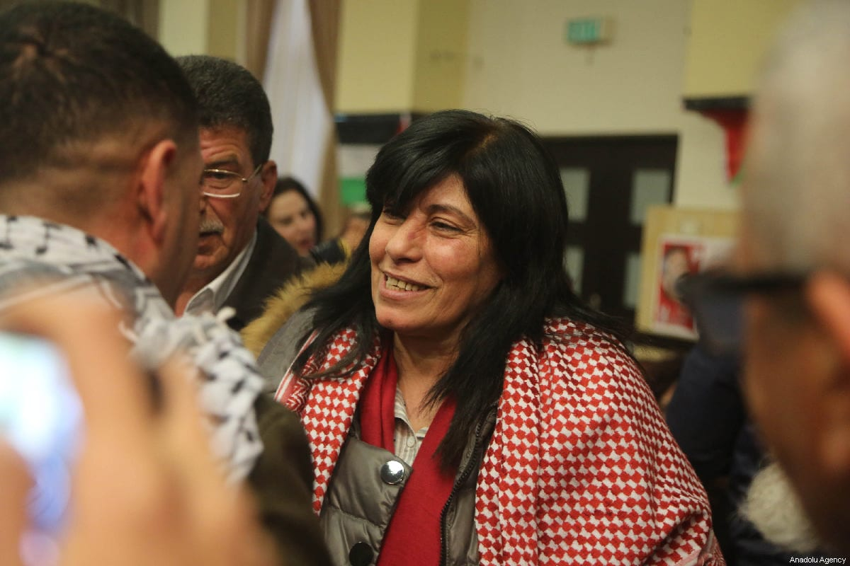Member of Palestinian Popular Front for the Liberation of Palestine (PFLP) and former lawmaker at the Palestinian Legislative Council (PLC) Khalida Jarrar (C) is seen as she is welcomed by her supporters and relatives after she was released from detention lasted 20 months, at her house in Nablus, West Bank on 28 February 2019. [Issam Rimawi - Anadolu Agency]