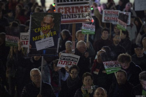 Demonstrators hold placards and shout slogans during the protest against Israeli Prime Minister Benjamin Netanyahu in Tel Aviv, Israel on 3 March 2019. [Faiz Abu Rmeleh - Anadolu Agency]