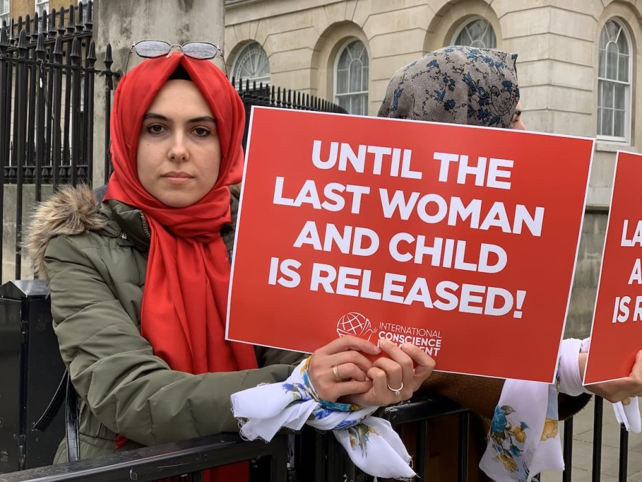 A woman holds banner during a protest staged by members of Movement of Conscience for releasing of women and children in Syrian prisons, in London, United Kingdom on 8 March 2019. [Hasan Esen - Anadolu Agency]