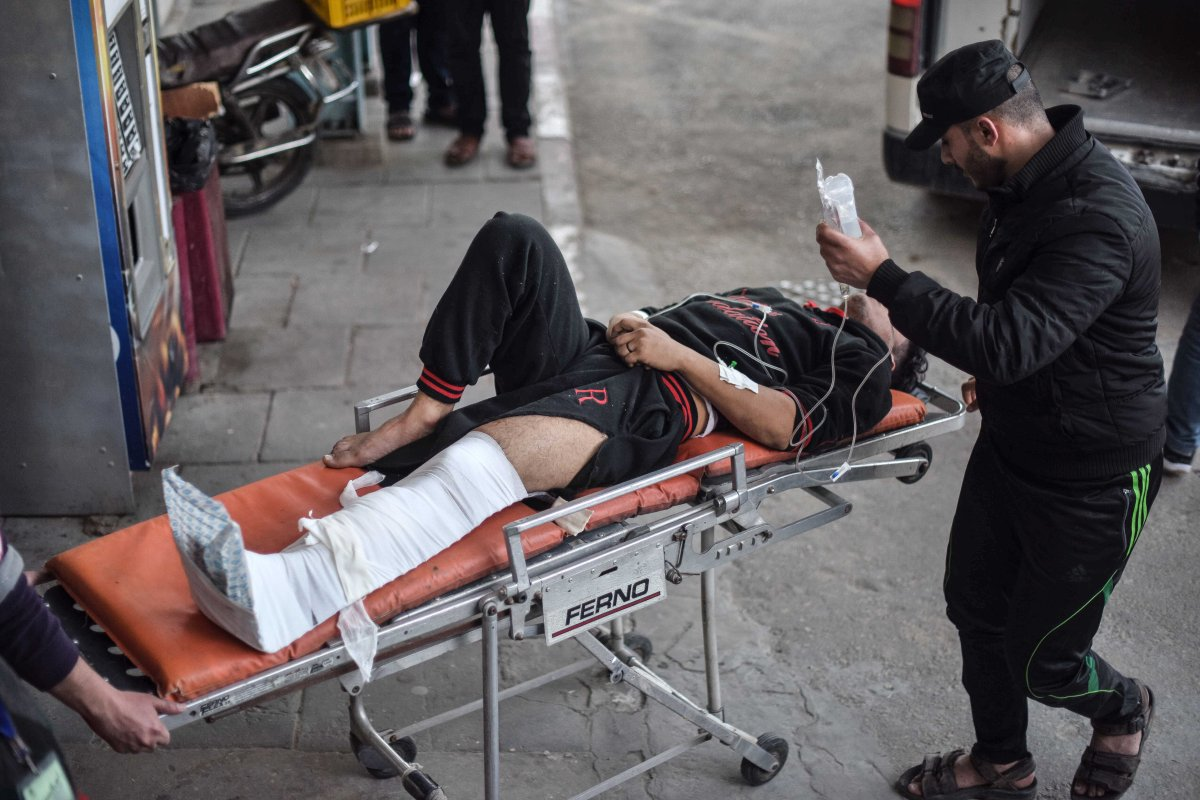 """An injured Palestinian is being carried away with a stretcher after Israeli forces's intervention during """"Great March of Return"""" demonstration, at the European Hospital in Khan Yunis, Gaza on 8 March, 2019 [Abed Zagout/Anadolu Agency]"""