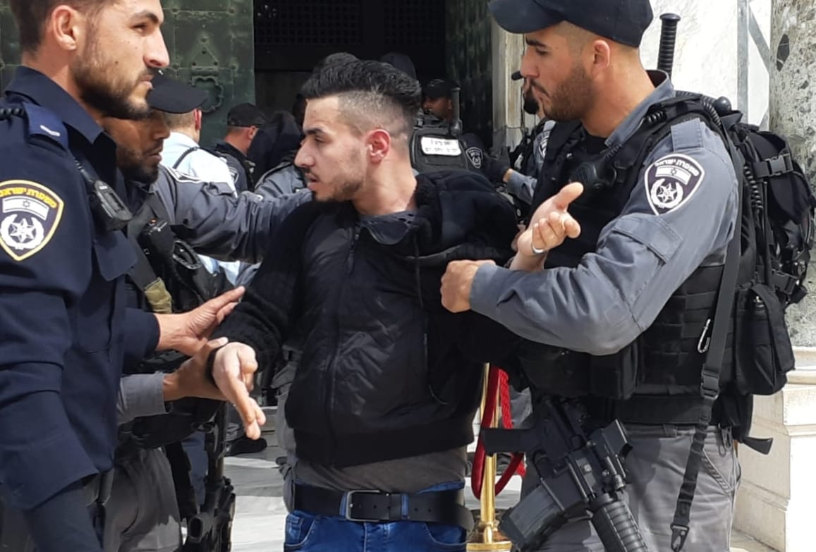 Israeli police officers take a man into custody near the Dome of the Rock mosque at Al-Aqsa mosque compound in Jerusalem on 12 March 2019. [Press Office of Jerusalem Islamic Foundations /Handout - Anadolu Agency]