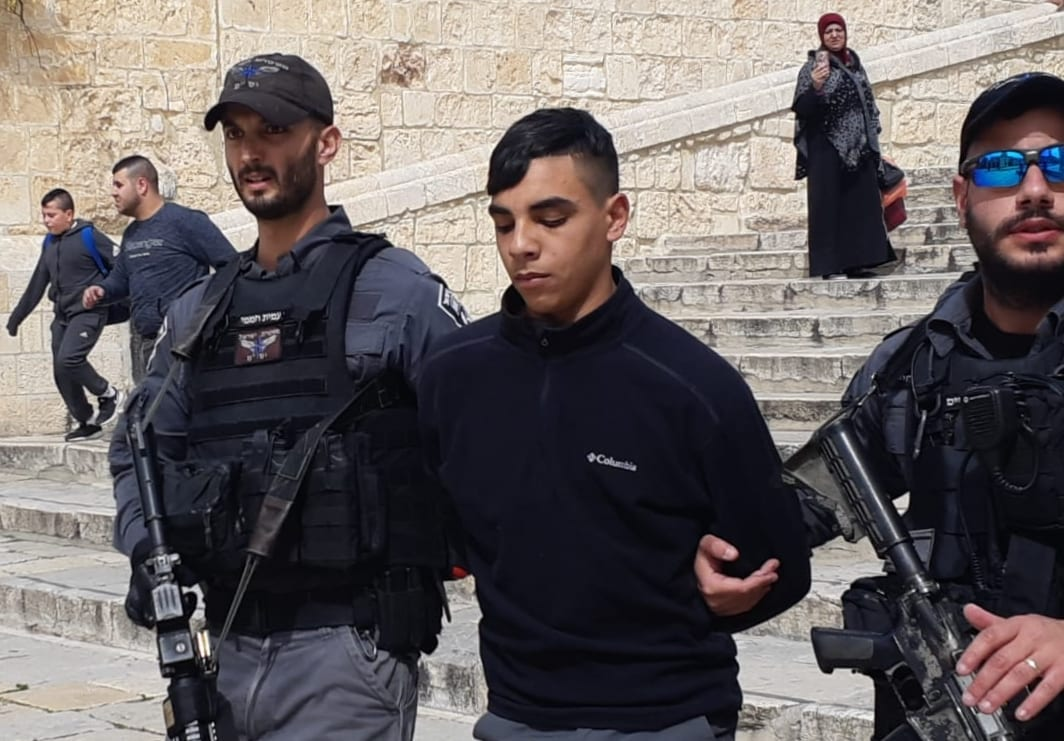 Israeli police officers take a man into custody near the Dome of the Rock mosque at Al-Aqsa mosque compound in Jerusalem on March 12, 2019. [Press Office of Jerusalem Islamic Foundations /Handout - Anadolu Agency]
