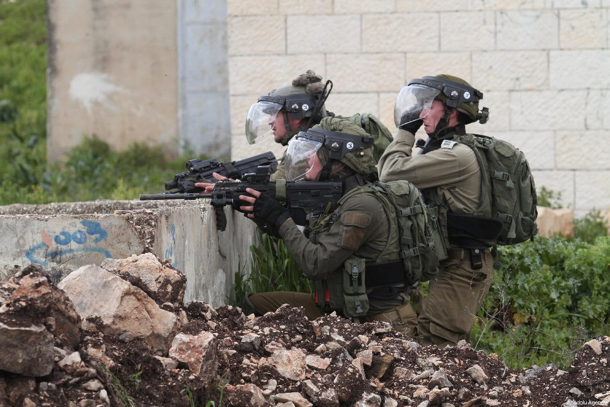 Israeli forces fire at Palestinian protesters during a protest in the West Bank on 15 March 2019 [Nedal Eshtayah/Anadolu Agency]