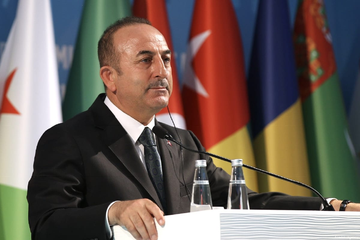 """Turkish Foreign Minister Mevlut Cavusoglu and OIC Secretary-General Yousef bin Ahmad Al-Othaimeen (not seen) hold a joint press conference after """"Organization of Islamic Cooperation (OIC) Emergency Open-Ended Executive Committee Meeting at the Level of Foreign Ministers on the Terrorist Attack Against Two Mosques in New Zealand and on Countering Hatred and Intolerance against Muslims"""" in Istanbul, Turkey on 22 March 2019 [Fatih Aktaş/Anadolu Agency]"""
