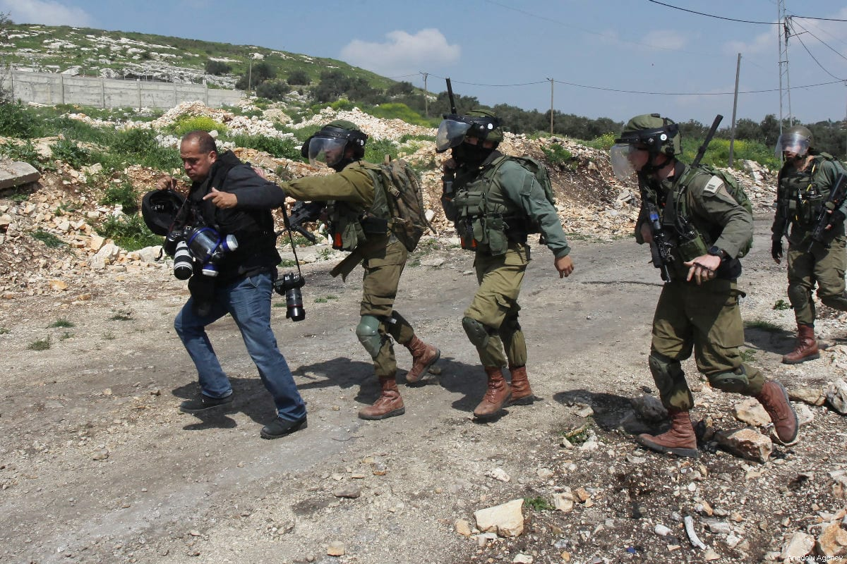 Israeli forces intervene in AFP'S photo journalist Jafer Eshtayah during a protest against building of Jewish settlements and separation wall at Kafr Qaddum village of Nablus, West Bank on 22 March 2019 [Nedal Eshtayah/Anadolu Agency]