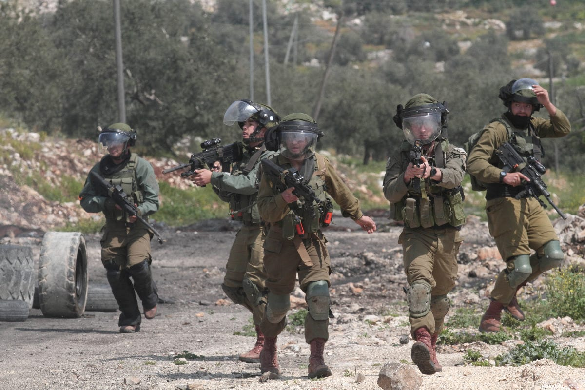 Israeli forces intervene in a protest against building of Jewish settlements and separation wall at Kafr Qaddum village of Nablus, West Bank on 22 March 2019 [Nedal Eshtayah/Anadolu Agency]