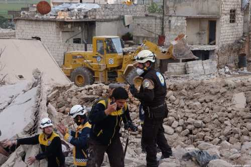 Civil defence members conduct a search and rescue operation under the rubbles of demolished buildings after airstrikes hit the residential areas of de-escalation zone Idlib, Syria on March 22, 2019 [Hasan Muhtar/Anadolu Agency]