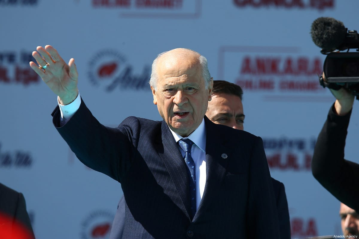 Chairman of the Nationalist Movement Party (MHP) Devlet Bahceli greets the crowd during a joint election rally of People's Alliance ahead of March 31 local elections in Ankara, Turkey on March 23, 2019 [Volkan Furuncu / Anadolu Agency]