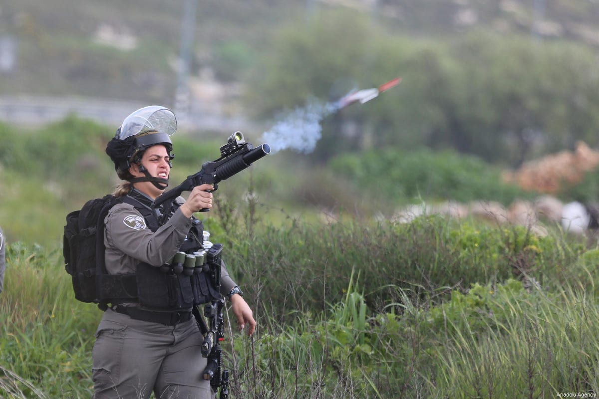 An Israeli soldier fires at Palestinian protesters in Ramallah, West Bank on 27 March 2019 [İssam Rimawi/Anadolu Agency]