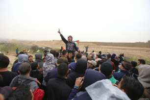 """Palestinians seen at the anniversary march of the """"Great March of Return"""" and """"Palestinian Land Day"""" protests at Israel-Gaza border located near Al Bureij Refugee Camp in Gaza City, Gaza on March 30, 2019 [Hassan Jedi / Anadolu Agency]"""