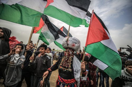 """Palestinians take part in a protest within the """"Great March of Return"""" and """"Palestinian Land Day"""" demonstrations in east of Shuja'iyya neighborhood, Gaza City, Gaza on March 30, 2019 [Ali Jadallah / Anadolu Agency]"""