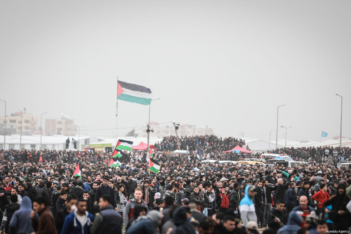 Palestinians protest during the Great March of Return in Gaza on 30 March 2019. [Ali Jadallah/Anadolu Agency]