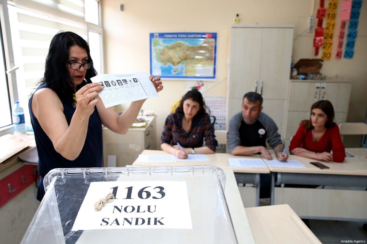 A scrutineers holds a ballot paper after the polls for the local elections closed at a polling station in Ankara, Turkey on 31 March, 2019 [Raşit Aydoğan/Anadolu Agency]