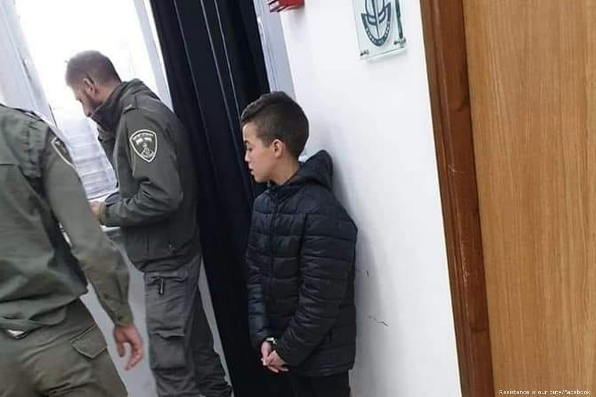 13-year-old Palestinian child, Adam Abu Ryalah can be seen in policy custody after Israeli forces detained him on 10 February 2019 [Resistance is our duty/Facebook]
