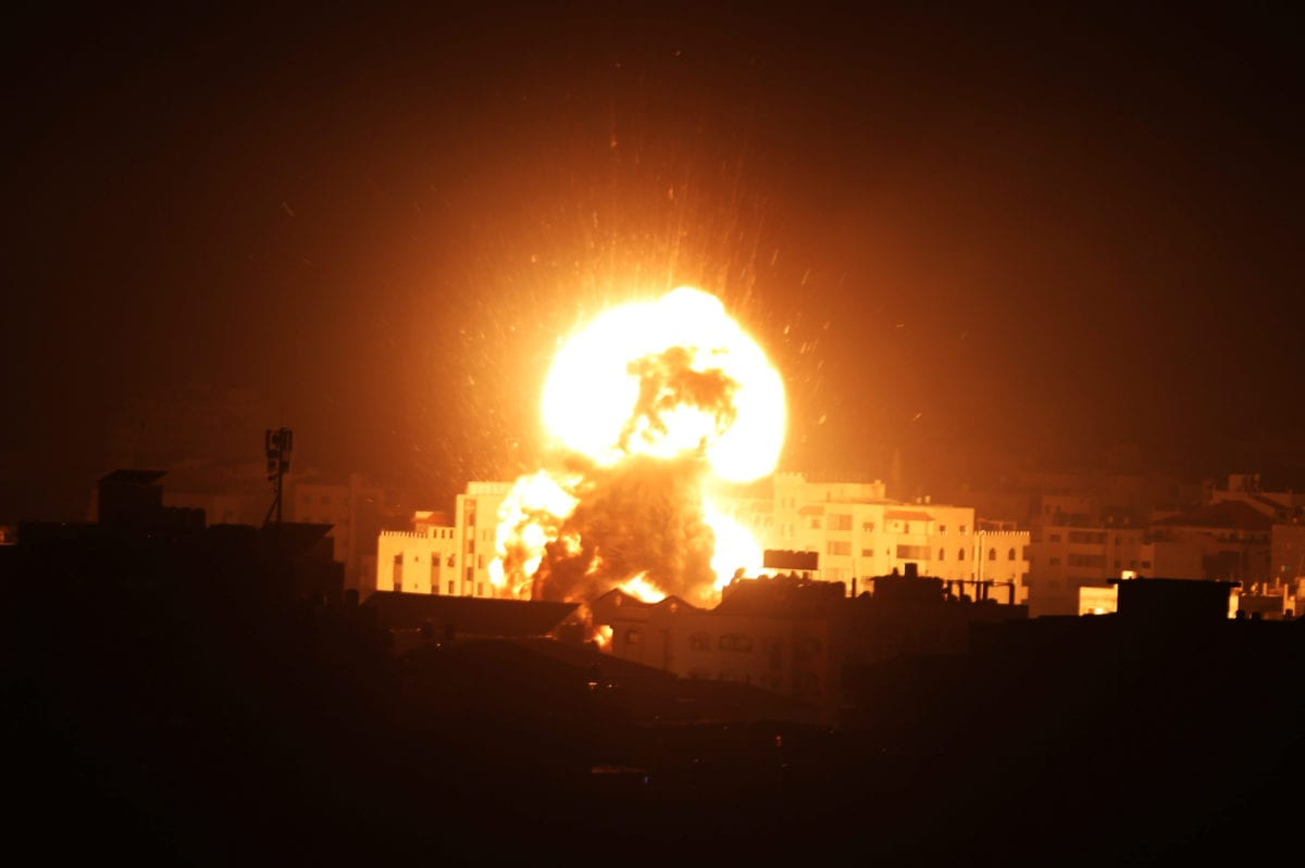 A ball of fire is seen following an Israeli air strike on building believed to house the offices of Hamas chief in Gaza, Ismail Haniyeh, during Israeli strikes on the Gaza City, March 25, 2019 [Ashraf Amra / ApaImages]