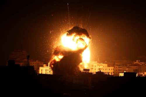 A ball of fire is seen following an Israeli air strike on building believed to house the offices of Hamas chief in Gaza, Ismail Haniyeh, during Israeli strikes on the Gaza City, 25 March, 2019 [Ashraf Amra/Apaimages]